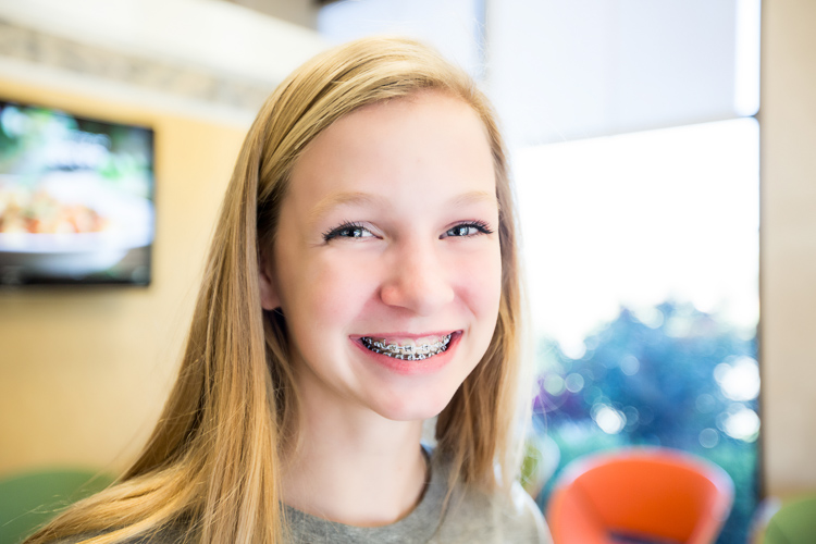 Blonde teenage girl with braces